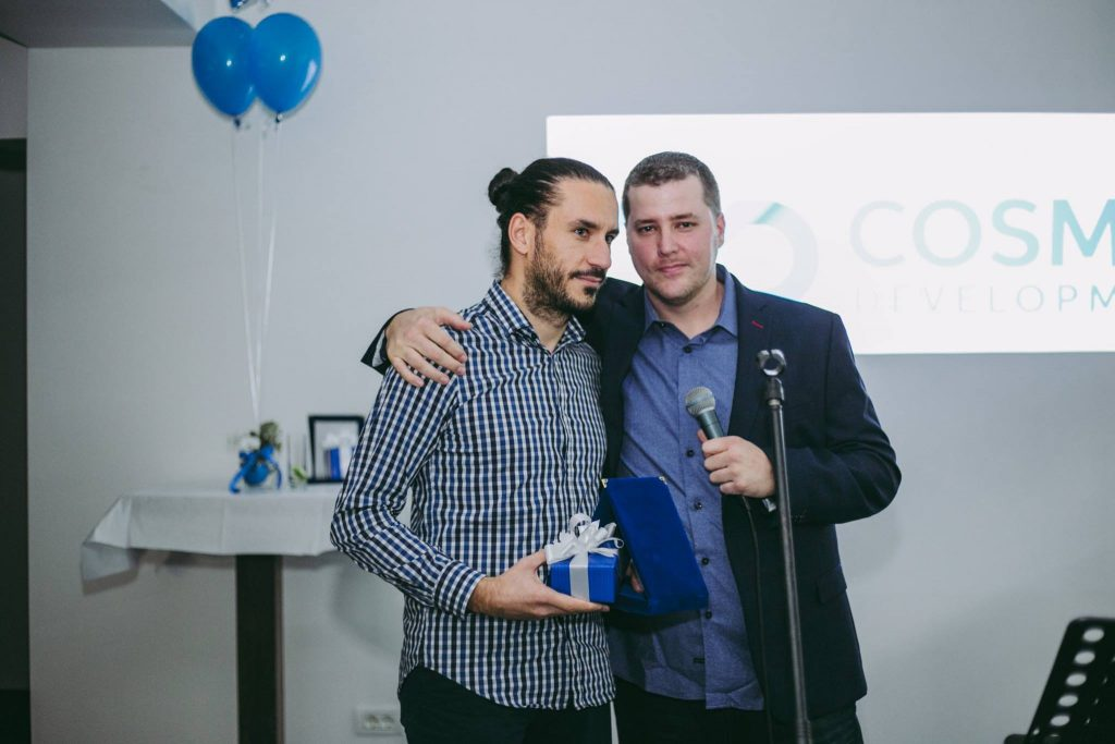 Atanas receives an award for working with Cosmic