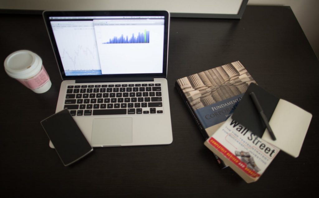 books and laptop on a desk