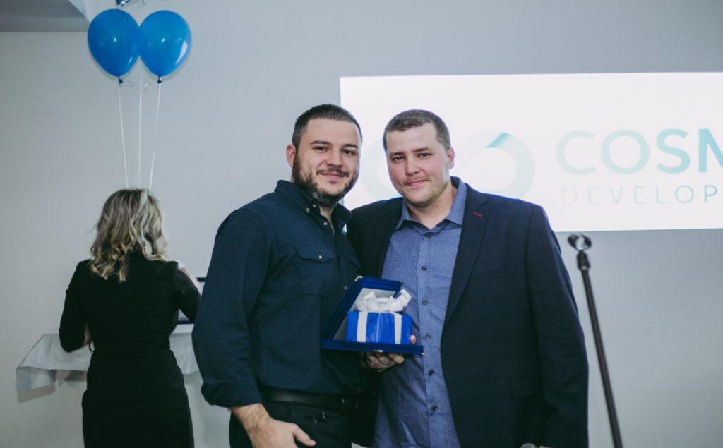 Atanas Krangov receiving an award from Ryan Milnes