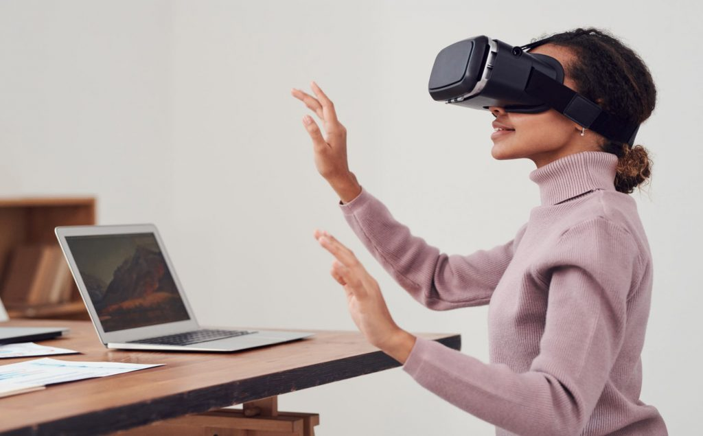 A girl trying out Virtual Reality as one of the web development trends