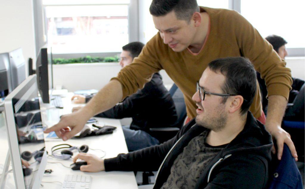 VP of Engineering working with his team member