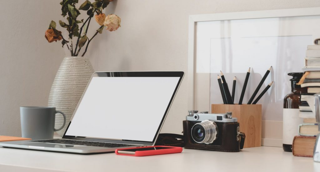 laptop and camera and using video marketing tools
