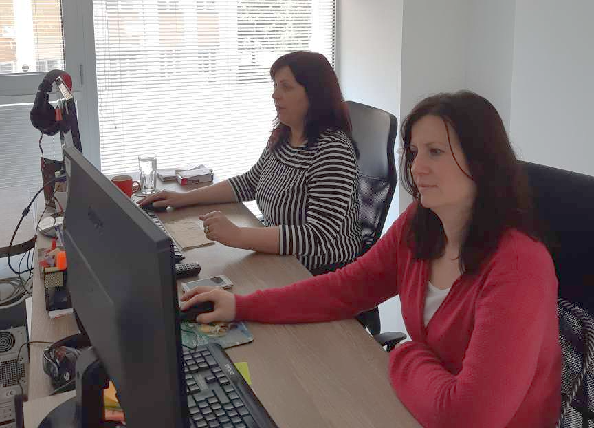 Daniela and her colleague Janet working on social media marketing