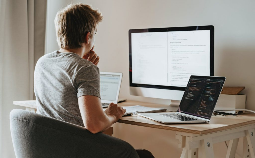Man programming and managing a project