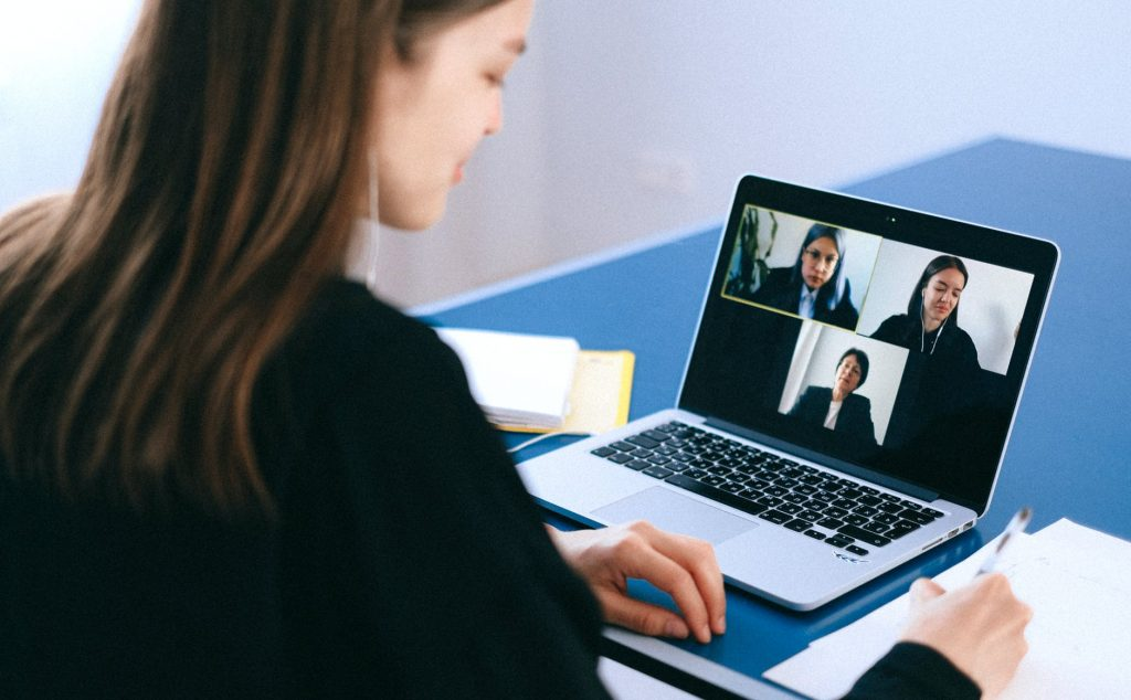 Woman having online meeting with the remote agile teams